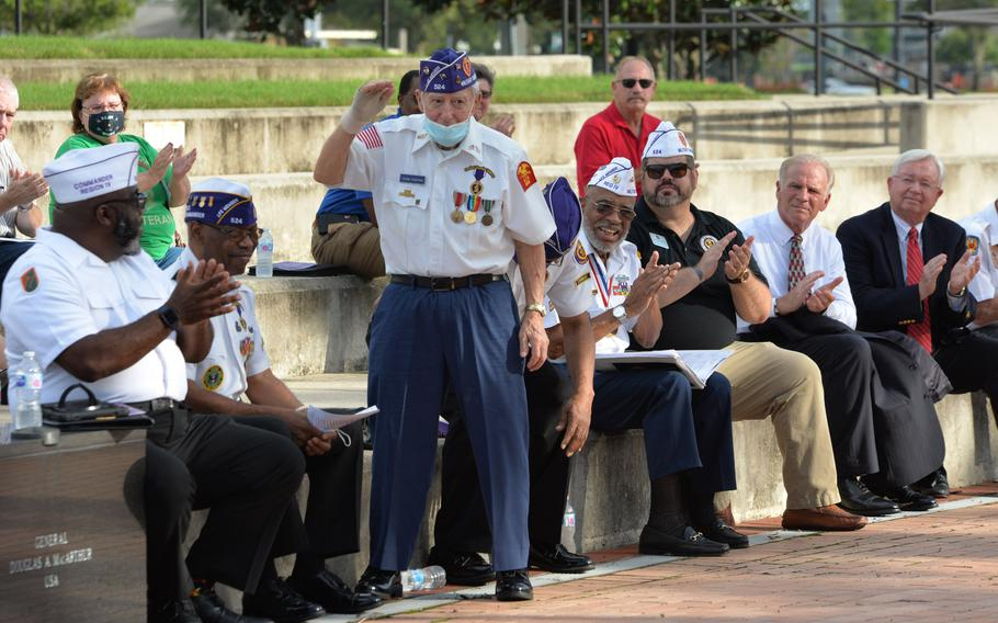 U.S. Navy and D-Day veteran Frank Purpura, 95, stands to be honored on Friday, Aug. 6, 2021, during a tribute to Purple Heart recipients.