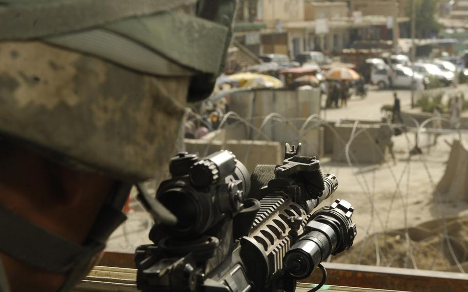 From his overwatch tower, U.S. Air Force Staff Sgt. Steven Lugo-Velez can see much of the town surrounding Bagram Airfield, Afghanistan in 2009.