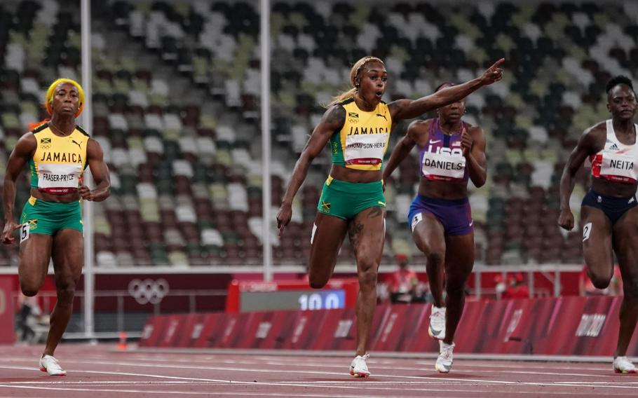 Elaine Thompson-Herah of Jamaica celebrates as she crosses the finish line to win gold in the women's 100-meter final.