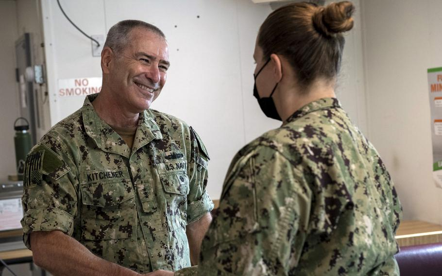 Vice Adm. Roy Kitchener, commander of Naval Surface Force, U.S. Pacific Fleet, speaks with a sailor assigned to the USS Preble on May 20, 2021, while the ship was in San Diego.