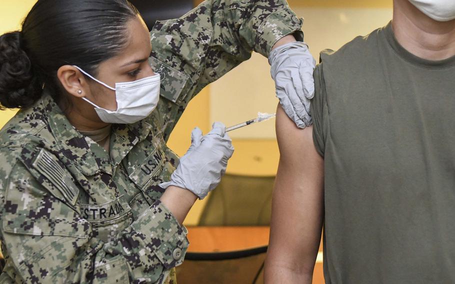 Seaman Denisse Estrada-Suarez administers the Pfizer COVID-19 vaccine to a Marine at Camp Lejeune, N.C., in June 2021.