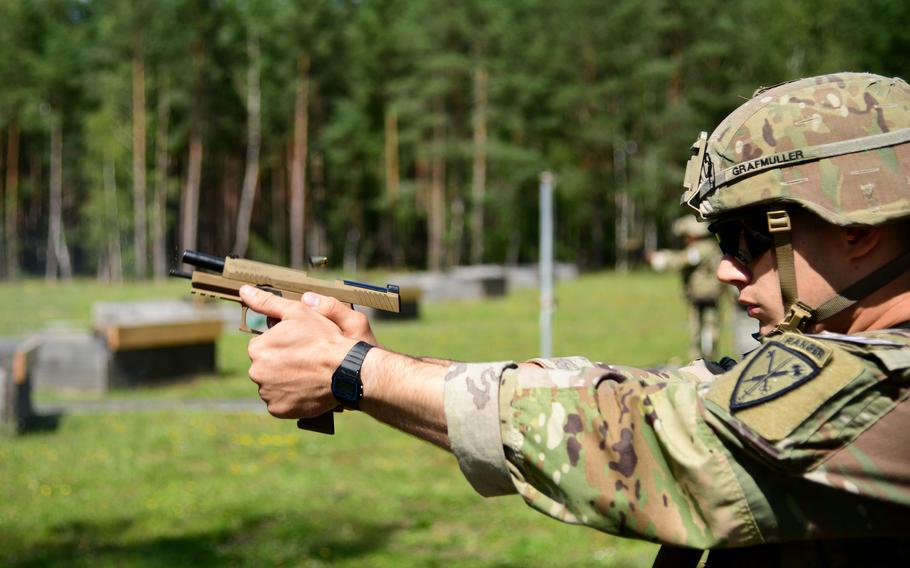 Sgt. Brent Grafmuller, from the 18th Military Police Brigade, fires an M17 pistol as part of the weapons qualification portion of the U.S. Army Europe and Africa Best Warrior competition in Grafenwoehr, Germany, Aug. 9, 2021. Grafmuller won the noncommissioned officer competition.