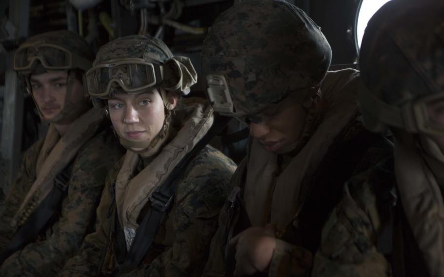 Marine Corps Cpl. Nicole Gee, second from left, a maintenance technician with 24th Marine Expeditionary Unit, awaits the launch of an MV-22B Osprey during an exercise aboard the Wasp-class amphibious assault ship USS Iwo Jima on April 5, 2021.  Gee was one of the 13 U.S. service members killed in a terrorist attack in Kabul on Thursday.