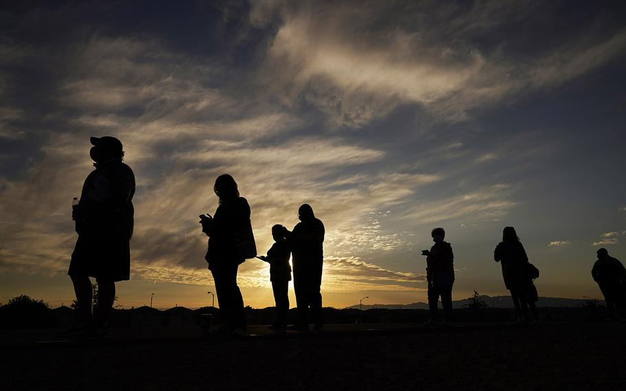 People wait in line to vote at a polling place before it opened on Election Day, Tuesday, Nov. 3, 2020, in Las Vegas. (AP Photo/John Locher)