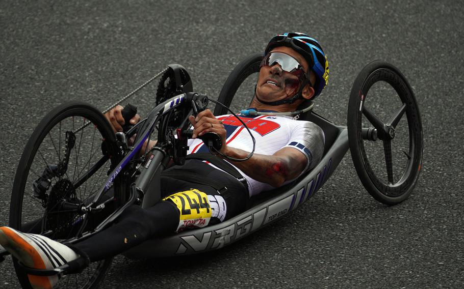 Paralympic cycler William Groulx, a Navy veteran, came off the circuit with some nasty abrasions after crashing at Fuji International Speedway outside Tokyo, Tuesday, Aug. 31, 2021.
