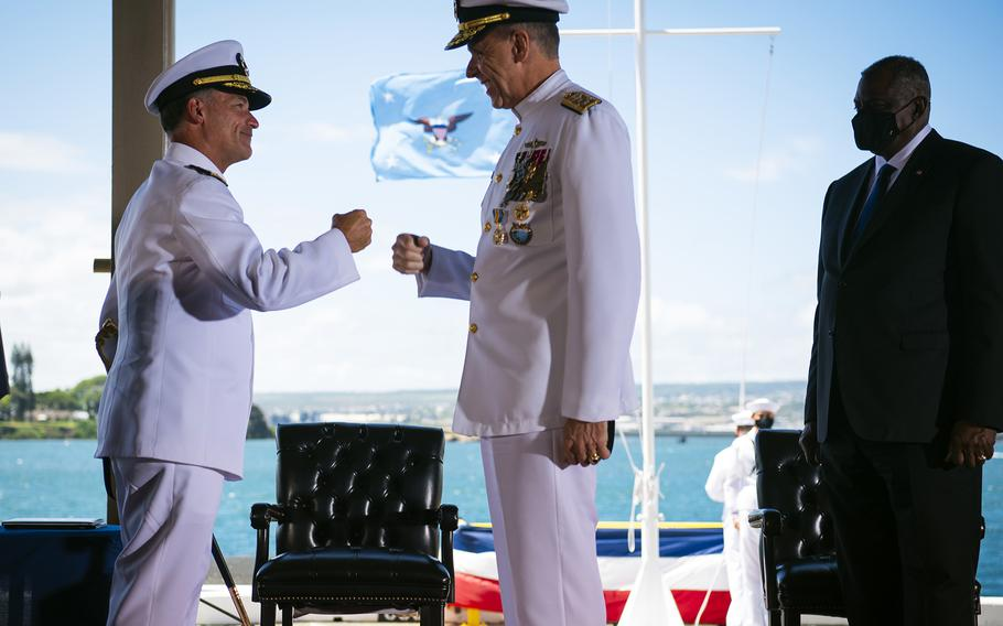 Adm. John Aquilino, left, relieves Adm. Philip Davidson, center, as leader of U.S. Indo-Pacific Command, during a ceremony at Joint Base Pearl Harbor-Hickam, Hawaii, Friday, April 30, 2021. Defense Secretary Lloyd Austin stands at right.
