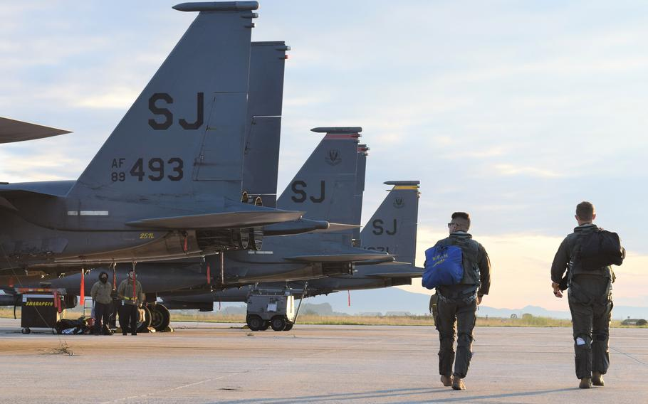 Airmen from the 336th Fighter Squadron, 4th Fighter Wing, Seymour Johnson Air Force Base, N.C., prepare their F-15E Strike Eagles for training with the Greek air force at Larissa Air Base, Greece, Oct. 11, 2021. The U.S. will gain greater access to an array of Greek military bases under a revised defense cooperation deal between the countries.