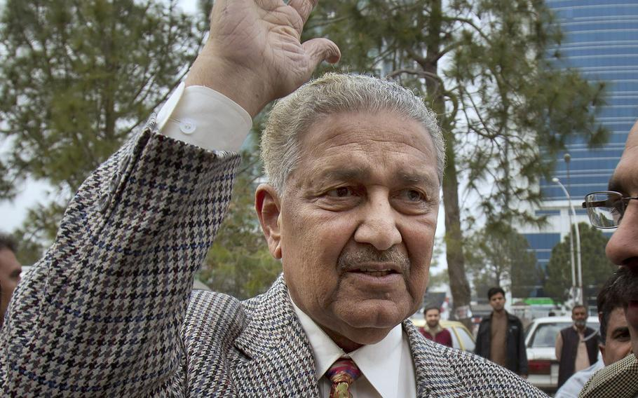 In this Feb. 26, 2013, file photo, Pakistan's nuclear scientist Abdul Qadeer Khan waves to supporters in Islamabad, Pakistan. Known as the father of Pakistan's nuclear bomb, Khan, died Sunday, Oct. 10, 2021 following a lengthy illness. He was 85.