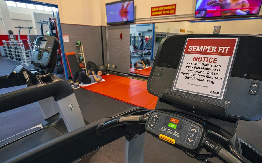 A sign urges gymgoers to practice social distancing to combat the spread of the coronavirus earlier this spring at Marine Corps Air Station Iwakuni, Japan.