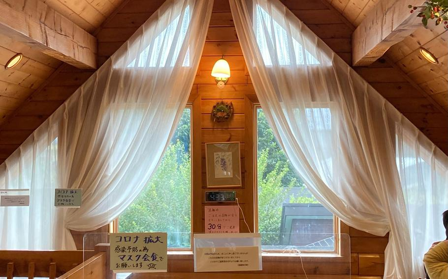 The interior of Berry Cottage's cafe in Ome, Japan, is designed to feel like a charming woodland cottage.
