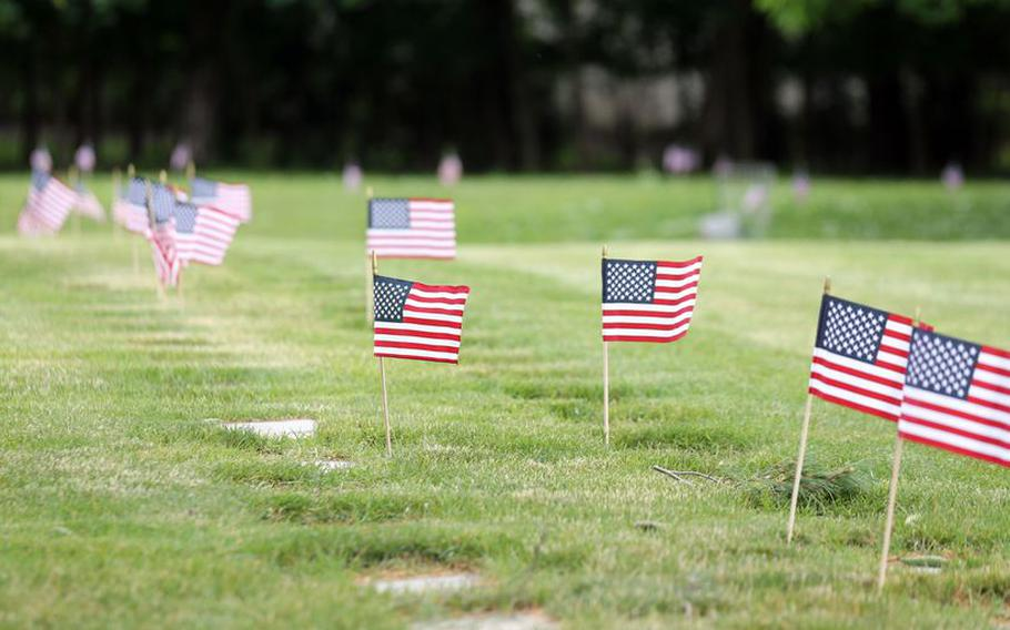 Flags line the rows of headstones  for military service members on Memorial weekend at Lakewood Park cemetery.