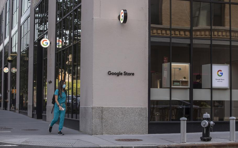 A pedestrian passes in front of the Google Store Chelsea in New York on May 28, 2021.