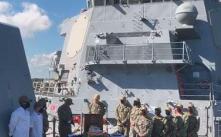 U.S. Navy Rear Adm. Brendan McLane (at podium) announces Task Group Greyhound aboard U.S.S. Thomas Hudner in Mayport.