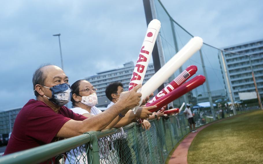 Spectators watch the U.S. Women's Olympic softball team's exhibition game against the Iyo Bank Vertz in Iwakuni, Japan, July 9, 2021.