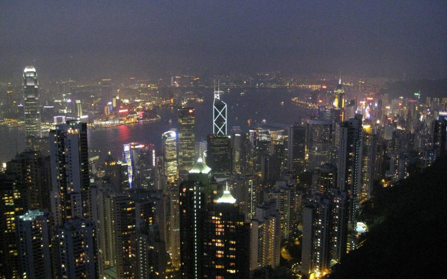 A night view of Victoria Peak in Hong Kong during a port visit by the nuclear-powered aircraft carrier USS Nimitz.