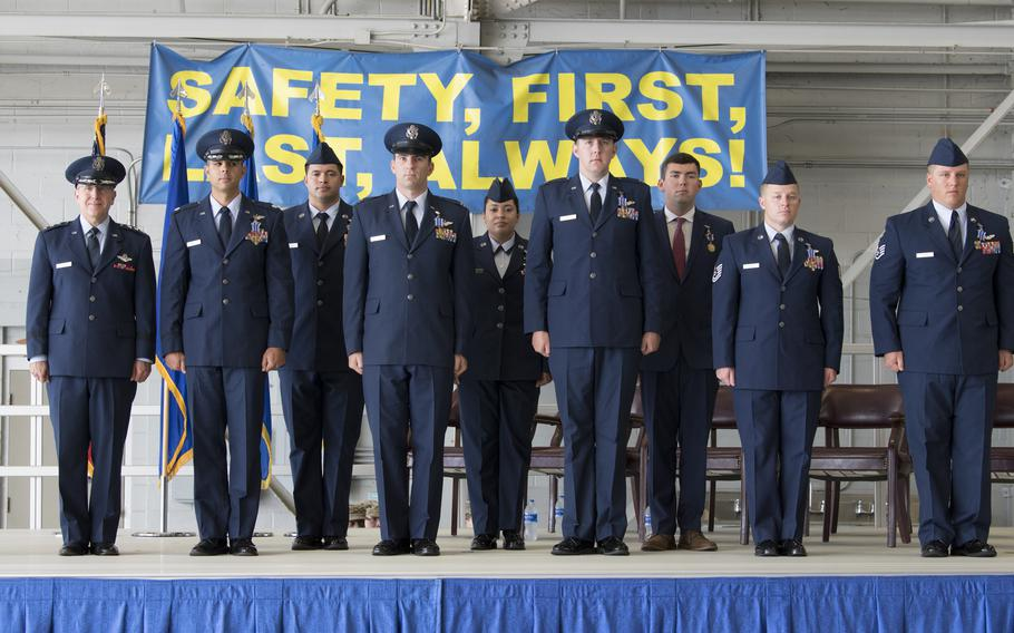 The crew of Shadow 71 pose after receiving the Distinguished Flying Cross and an Air Medal during a ceremony at Hurlburt Field, Fla., June 22, 2021. The crew received the medals for their actions to protect ground forces in Afghanistan in September 2019.