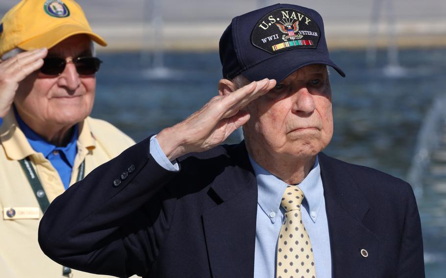 World War II veteran Callan Francis Saffel salutes as the national anthem is played during a Memorial Day ceremony at the National World War II Memorial in Washington, D.C., May 31, 2021.