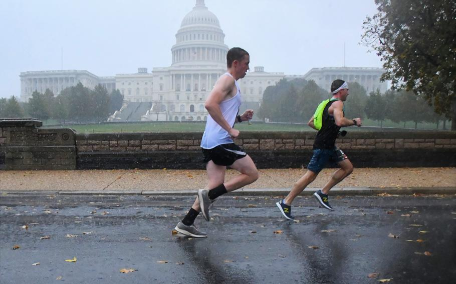 Runners in the 2019 Marine Corps Marathon pass the U.S. Capitol in Washington, D.C., at about 19 miles into the 26.2-mile race.