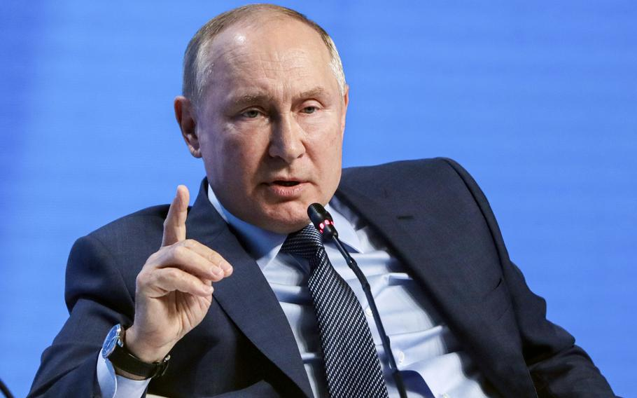 Russian President Vladimir Putin gestures while speaking at the plenary session of the Russian Energy Week in Moscow, Russia, Wednesday, Oct. 13, 2021.