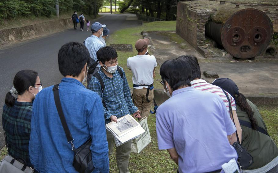 """Japanese visitors take part in an """"eco tour"""" at Tama Hills, a U.S. military recreation area in western Tokyo, Wednesday, May 26, 2021."""