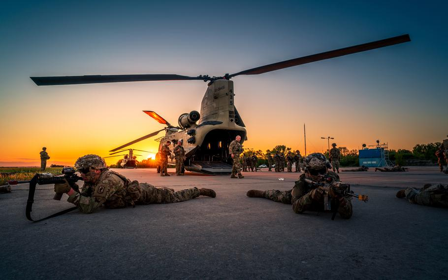 U.S. 173rd Airborne Brigade soldiers rehearse exiting a CH-47 Chinook in preparation for night air assault missions during the Swift Response 21 exercise at Chech Airfield, Bulgaria, on May 11, 2021.