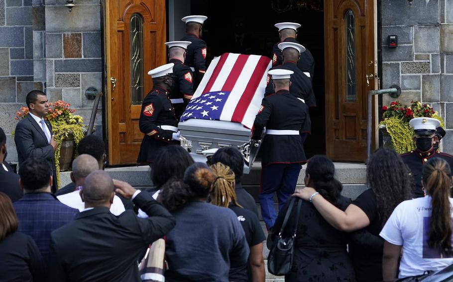 The coffin of Sgt.  Johanny Rosario Pichardo, a U.S. Navy who was among 13 servicemen killed in a suicide bombing in Afghanistan, is transported to Farrah's funeral home in his hometown of Lawrence, Mass, on Saturday, September 11, 2021.