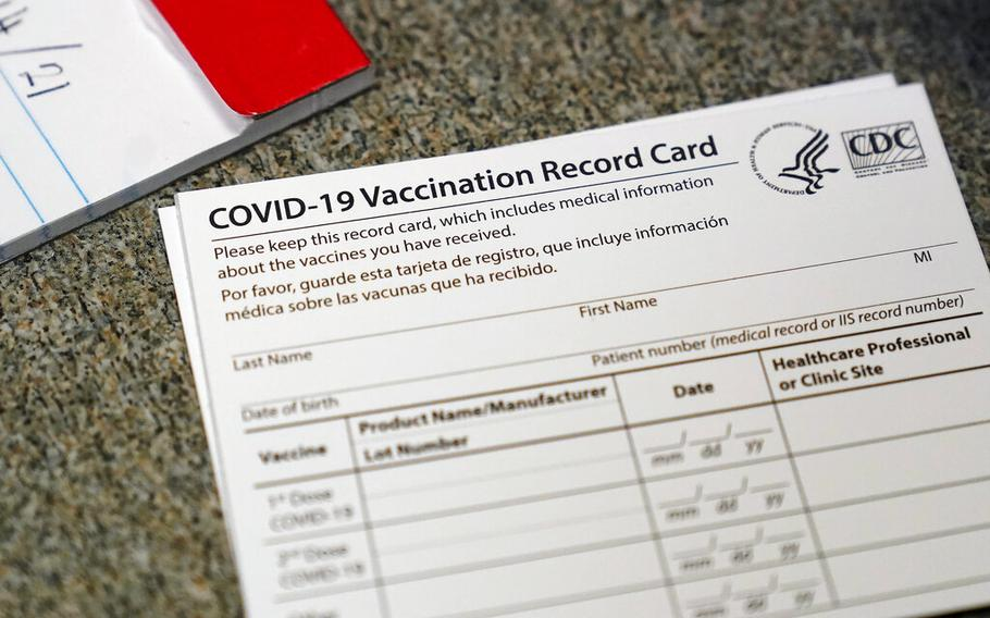 In this Dec. 24, 2020, file photo, a COVID-19 vaccination record card is shown at Seton Medical Center in Daly City, Calif. Los Angeles leaders are poised to enact one of the nation's strictest vaccine mandates, a sweeping measure that would require the shots for everyone entering a bar, restaurant, nail salon, gym or even a Lakers game. The City Council on Wednesday, Oct. 6, 2021, is scheduled to consider the proposal and most members have said they support it as a way of preventing further COVID-019 surges.
