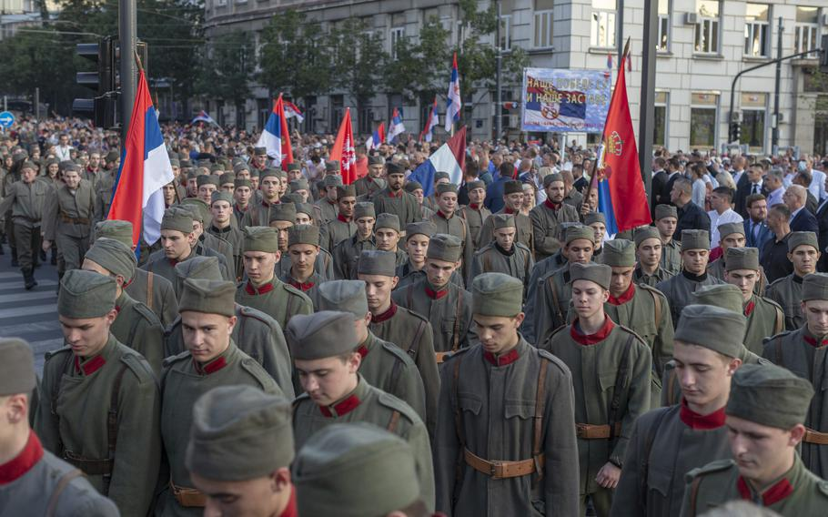 """Actors dressed in Serbian WWI military uniform replicas during a ceremony to mark the newly established """"Day of Serb Unity, Freedom and the National Flag"""" state holiday in Belgrade, Serbia, Wednesday, Sept. 15, 2021."""