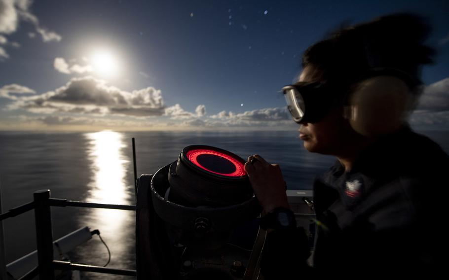 Petty Officer 2nd Class Edmond Nazareno checks a gyro repeater compass while standing watch aboard the amphibious assault ship USS Kearsarge in the Atlantic Ocean in 2018.  A recent U.S. Government Accountability Office report says despite a 2017 Navy policy aimed at managing fatigue, the Navy has inconsistently implemented the policy and sailors still are not getting adequate sleep.