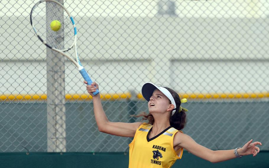 Kadena's Megan Fife hits an overhead smash during Wednesday's Okinawa tennis matches. Fife and teammate Elizabeth Cheramie beat Kubasaki's Lillian Law and Faith Reilly 8-6.