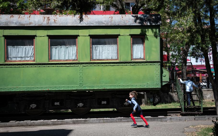 Children play at a park by the Stalin Museum in Gori, Georgia, on May 18. Joseph Stalin took the green rail coach to the World War II conference with the Allied leaders in Tehran.