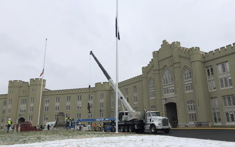 """Crews lift a statue of Confederate Gen. Thomas """"Stonewall"""" Jackson from its pedestal on the campus of the Virginia Military Institute in Lexington, Va., on Dec. 7, 2020."""