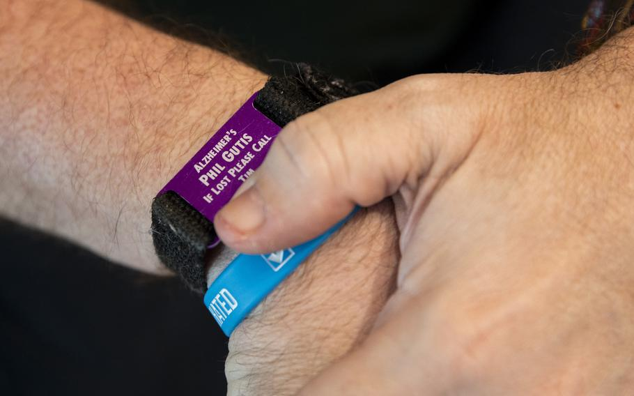 Phil Gutis wears an identification bracelet in case he gets lost from his home in New Hope, Pa.