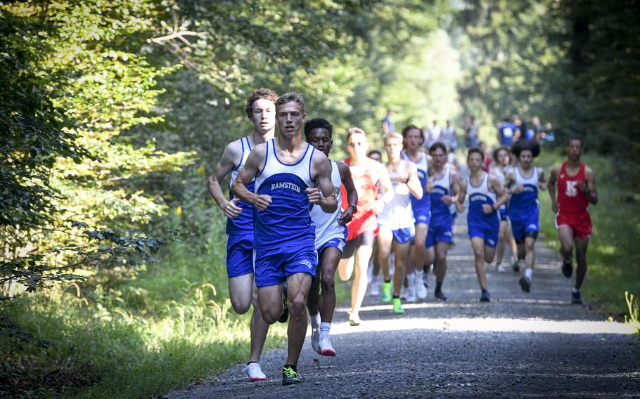 Gideon Zaugg, 17, a senior at Ramstein, bolts out in front of the pack during the beginning of a high school boys' varsity cross country race Saturday, Sept. 18, 2021, in Kaiserslautern, Germany.