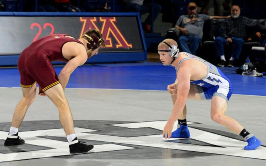 Air Force Academy cadet Tanner Johnson, right, wrestles against a University of Minnesota athlete in 2018. He continued wrestling competitively after he was diagnosed with Type 1 diabetes at the start of his senior year.