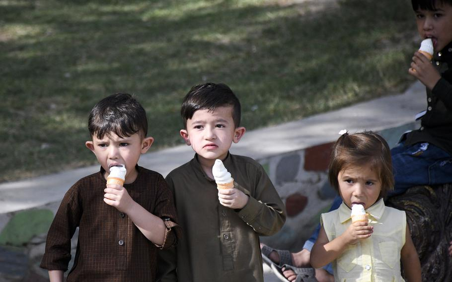 Children enjoy ice cream cones at the Kabul Zoo in Afghanistan on Aug. 12, 2021, just days before the city fell to the Taliban.