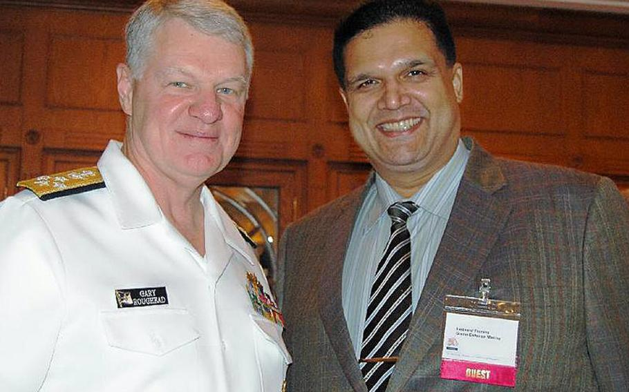 """In this undated photo, former Chief of Naval Operations Adm. Gary Roughead poses with Leonard Glenn Francis, also known as """"Fat Leonard,"""" who admitted to bribing Navy officials with cash, luxury travel and prostitutes for classified or inside information that benefited his firm. Roughead was not implicated in the case."""