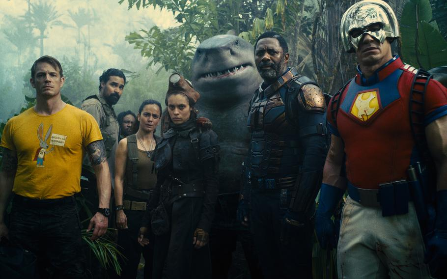 """Left to right: Joel Kinnaman as Colonel Rich Flag, Alice Braga as Sol Soria, Daniela Melchior as Ratcatcher 2, King Shark, Idris Elba as Bloodsport and John Cena as Peacemaker in Warner Bros. Pictures' superhero action adventure """"The Suicide Squad."""""""
