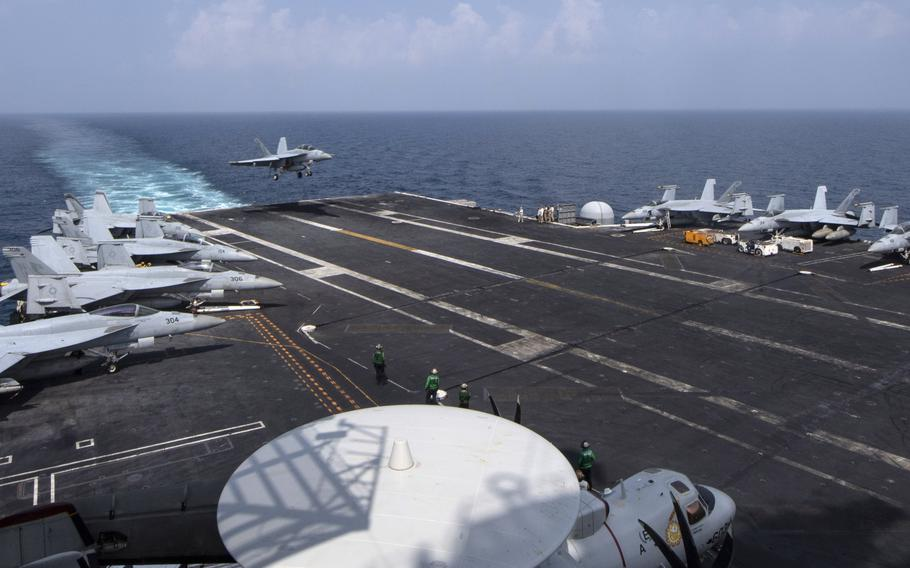 An F/A-18F Super Hornet lands on the aircraft carrier USS Nimitz in the Persian Gulf in October 2020. Nearly half of Americans polled recently by the Eurasia Group Foundation think U.S. military activities abroad should be reduced.