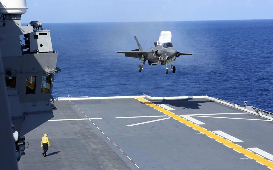 A Marine Corps F-35B Lightning II stealth fighter makes a vertical landing aboard the JS Izumo, a Japanese helicopter carrier, in the Philippine Sea, Sunday, Oct. 3, 2021.