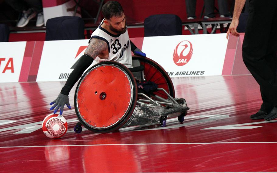 Former Marine Raymond Hennagir scored three times in Team USA's wheelchair rugby win over New Zealand during their Tokyo Paralympics matchup, Wednesday, Aug. 25, 2021.