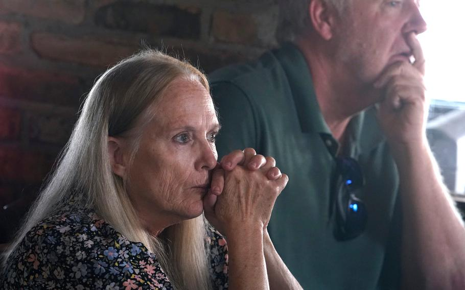 Karen Anderson listens to a story during a gathering of the Gold Star Mothers and Families in New Smyrna Beach, Fla., Sept. 18, 2021.