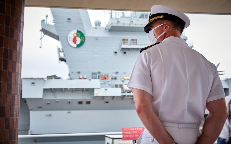 Installation commander Capt. Rich Jarrett watches the HMS Queen Elizabeth steam into Yokosuka Naval Base, Japan, Saturday, Sept. 4, 2021.