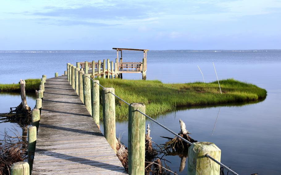 A dock extends off Chincoteague Island and into Chincoteague Bay.