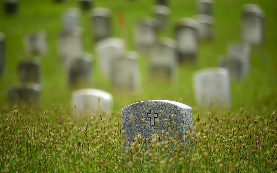 Headstones are surrounded by uncut grass at Northwood Cemetery/Soldiers Field in Windsor.