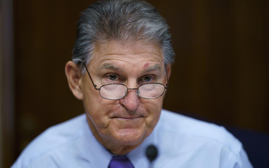"""In this Aug. 5, 2021, photo, Sen. Joe Manchin, D-W.Va., prepares to chair a hearing in the Senate Energy and Natural Resources Committee. Manchin said Sept. 2, 2021, that Congress should take a """"strategic pause"""" on more spending, warning that he does not support President Joe Biden's plans for a sweeping $3.5 trillion effort to rebuild and reshape the economy."""