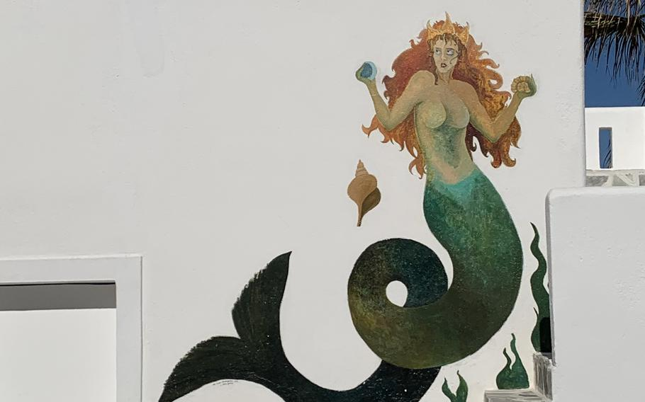 A colorful mermaid mural brightens up quintessential whitewashed walls in Naousa.
