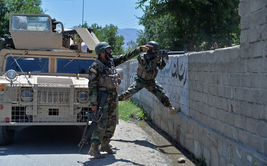 Members of Afghan security forces take their positions during an ongoing clash between Taliban and Afghan forces in Mihtarlam, the capital of Laghman Province, on May 24, 2021, as the insurgents pressed on with their campaign to seize new territories as the U.S. military continued with its troop pullout.
