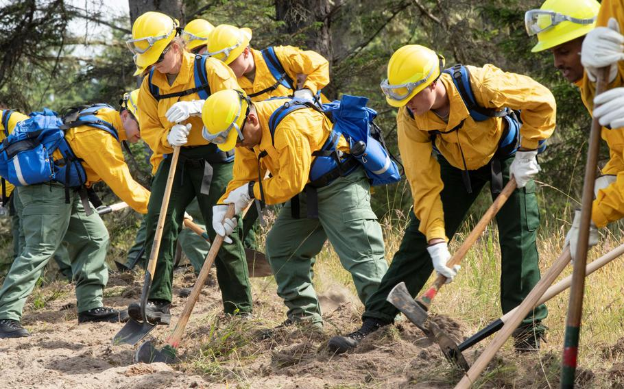 Oregon National Guard soldiers and airmen trained in June for the 2021 wildfire season. Troops are now deployed in the state, which is one of about 14 dealing with fires throughout the West.