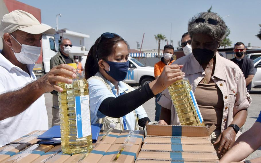 Linda Thomas-Greenfield, U.S. Ambassador to the United Nations, examines aid materials at the Bab al-Hawa border crossing between Turkey and Syria, on June 3, 2021.